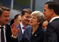 British Prime Minister Theresa May, center, speaks with Dutch Prime Minister Mark Rutte, right, and Luxembourg's Prime Minister Xavier Bettel, left, during a round table meeting at an EU summit in Brussels, on March 21, 2019. (AP Photo/Frank Augstein)
