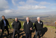 Israeli Prime Minister Benjamin Netanyahu, center, Republican U.S. Senator Lindsey Graham, second left, and U.S. Ambassador to Israel David Friedman, right, visit the border between Israel and Syria at the Israeli-held Golan Heights, on March 11, 2019. (Ronen Zvulun/Pool via AP)
