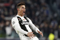 Juventus' Cristiano Ronaldo celebrates after scoring his side's third goal during the Champions League round of 16, 2nd leg, soccer match between Juventus and Atletico Madrid at the Allianz stadium in Turin, Italy, on March 12, 2019. (AP Photo/Antonio Calanni)