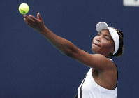Venus Williams tosses the ball to serve to Dalila Jakupovic, of Slovenia, at the Miami Open tennis tournament, on March 21, 2019, in Miami Gardens, Fla. (AP Photo/Lynne Sladky)