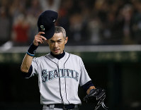 Seattle Mariners right fielder Ichiro Suzuki waves to spectators while leaving the field for defensive substitution in the eighth inning of Game 2 of the Major League baseball opening series against the Oakland Athletics at Tokyo Dome in Tokyo, on March 21, 2019. (AP Photo/Toru Takahashi)