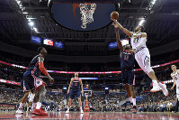 Denver Nuggets guard Jamal Murray (27) goes to the basket against Washington Wizards center Thomas Bryant (13), guard Tomas Satoransky (31) and forward Bobby Portis, left, during the second half of an NBA basketball game on March 21, 2019, in Washington. The Nuggets won 113-108. (AP Photo/Nick Wass)
