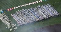 開会式で一斉行進する選手たち=兵庫県西宮市の阪神甲子園球場で2019年3月23日午前9時25分、本社ヘリから大西達也撮影