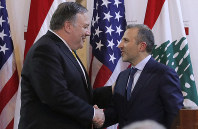 U.S. Secretary of State Mike Pompeo shakes hands with Lebanese Foreign Minister Gebran Bassil after a public statement in Beirut, Lebanon, on March 22, 2019. (Jim Young/Pool Image via AP)