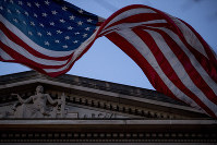 An American flag flies outside the Department of Justice in Washington, on March 22, 2019. (AP Photo/Andrew Harnik)