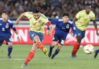 Radamel Falcao scores a 64th-minute penalty as Colombia got a measure of revenge on World Cup foes Japan in a 1-0 international friendly victory on March 22, 2019. (Kyodo)