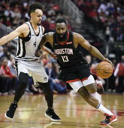 Houston Rockets guard James Harden (13) dribbles past San Antonio Spurs guard Derrick White during the second half of an NBA basketball game on March 22, 2019, in Houston. Houston won 111-105. (AP Photo/Eric Christian Smith)