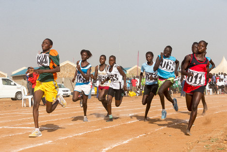 Athletes take part in a sports meet in South Sudan, with some running barefoot. (Photo courtesy of Shinichi Kuno/JICA)