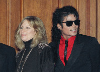 In this Dec. 14, 1986, file photo, singers Barbra Streisand and Michael Jackson attend the Scopus Awards of the American Friends of the Hebrew University ceremony in Los Angeles. Streisand is apologizing outright for her comments about sexual abuse allegations against Michael Jackson. She said in a second statement Saturday, March 23, 2019, that she should have chosen her words more carefully, and admires the accusers for