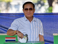Thailand's Prime Minister Prayuth Chan-ocha casts his vote at a polling station in Bangkok, Thailand, Sunday, March 24, 2019, during the nation's first general election since the military seized power in a 2014 coup. (AP Photo/Gemunu Amarasinghe)