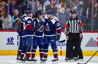 Colorado Avalanche right wing Sven Andrighetto (10), center Colin Wilson (22) and Samuel Girard (49) celebrate a goal against the Chicago Blackhawks during the third period of an NHL hockey game, Saturday, March 23, 2019 in Denver. (AP Photo/Jack Dempsey)