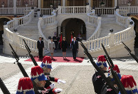 From left to right, Chinese President Xi Jinping, his wife Peng Liyuan, Prince Albert II of Monaco's wife, Princess Charlene and Prince Albert II of Monaco review the honor guards during a welcome ceremony at Monaco Palace, on March 24, 2019. (AP Photo/Olivier Anrigo)