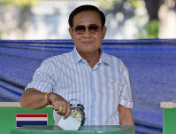 Thailand's Prime Minister Prayuth Chan-ocha casts his vote at a polling station in Bangkok, Thailand, on March 24, 2019, during the nation's first general election since the military seized power in a 2014 coup. (AP Photo/Gemunu Amarasinghe)