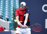 John Isner returns a volley to Albert Ramos-Vinglas, of Spain, during the Miami Open tennis tournament, on March 24, 2019, in Miami Gardens, Fla. (AP Photo/Joel Auerbach)
