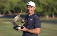 Paul Casey poses with the champions trophy after winning the Valspar Championship golf tournament on March 24, 2019, in Palm Harbor, Fla. (AP Photo/Mike Carlson)