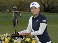 Jin Young-ko poses with the trophy after winning the Founders Cup LPGA golf tournament, on March 24, 2019, in Phoenix. (AP Photo/Matt York)