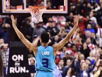 Charlotte Hornets guard Jeremy Lamb (3) celebrates his game-winning basket against the Toronto Raptors in an NBA basketball game Sunday, March 24, 2019, in Toronto. (Frank Gunn/The Canadian Press via AP)