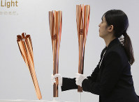 The Paralympic torches of the Tokyo 2020 Olympic Games are displayed during a press conference in Tokyo, on March 25, 2019. (AP Photo/Koji Sasahara)