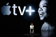 Oprah Winfrey speaks at the Steve Jobs Theater during an event to announce new Apple products on March 25, 2019, in Cupertino, California. (AP Photo/Tony Avelar)
