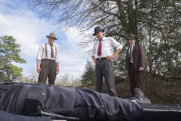 This image released by Netflix shows, from left, Woody Harrelson, Kevin Costner and Thomas Mann in a scene from