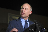 In this Nov. 14, 2018 file photo, Michael Avenatti speaks to the media outside the Los Angeles Police Department Pacific Division after posting bail for a felony domestic violence charge. (AP Photo/Michael Owen Baker)