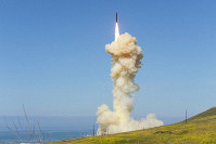 In this photo provided by the Missile Defense Agency, the lead ground-based Interceptor is launched from Vandenberg Air Force Base, California, in a