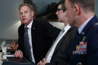 U.S. Acting Defense Secretary Patrick Shanahan, left, talks to media during a meeting with French Defense Minister Florence Parly at the Pentagon in Washington, on March 18, 2019. (AP Photo/Carolyn Kaster)