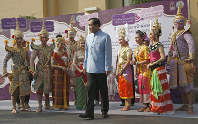 Thai Prime Minister Prayuth Chan-ocha, center, talks to performers in classic Ramayana, during an event to promote Thai Heritage Conservation Day before cabinet meeting at the government house in Bangkok, Thailand, on March 26, 2019. (AP Photo/Sakchai Lalit)