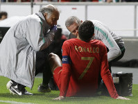 Portugal's Cristiano Ronaldo receives treatment from medical staff during the Euro 2020 group B qualifying soccer match between Portugal and Serbia at the Luz stadium in Lisbon, Portugal, on March 25, 2019. (AP Photo/Armando Franca)