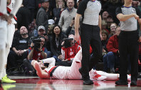 Portland Trail Blazers center Jusuf Nurkic, on ground, was injured and left the court on a stretcher as the Blazers beat the Brooklyn Nets in double overtime, 148-144, during an NBA basketball game in Portland, Oregon, on March 25, 2019. (AP Photo/Randy L. Rasmussen)