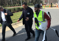 Matternet CEO Andreas Raptopoulos walks next to an operator carrying a drone used for delivery of medical specimens after a flight at WakeMed Hospital in Raleigh, North Carolina on March 26, 2019. (AP Photo/Jonathan Drew)