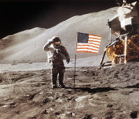 In this July 30, 1971 photo made available by NASA, Apollo 15 Lunar Module Pilot James B. Irwin salutes while standing beside the fourth American flag planted on the surface of the moon. On March 26, 2019, Vice President Mike Pence called for landing astronauts on the moon within five years. (NASA via AP)