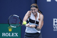 Petra Kvitova, of the Czech Republic, returns a volley to Caroline Garcia, of France, during the Miami Open tennis tournament, on March 25, 2019, in Miami Gardens, Fla. (AP Photo/Joel Auerbach)