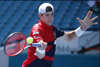John Isner, returns a volley to Kyle Edmund, of the United Kingdom, during the Miami Open tennis tournament, on March 26, 2019, in Miami Gardens, Fla. (AP Photo/Joel Auerbach)