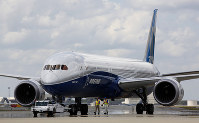 In this March 31, 2017, file photo, Boeing employees walk the new Boeing 787-10 Dreamliner down toward the delivery ramp area at the company's facility in South Carolina after conducting its first test flight at Charleston International Airport in North Charleston, S.C. (AP Photo/Mic Smith)