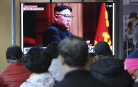 People watch a TV screen showing a file image of North Korean leader Kim Jong Un during a news program at the Seoul Railway Station in Seoul, South Korea, on April 12, 2019. (AP Photo/Ahn Young-joon)