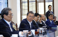 South Korean President Moon Jae-in, second from left, speaks during a meeting with his aids at the presidential Blue House in Seoul, South Korea, on April 15, 2019. (Bee Jae-man/Yonhap via AP)