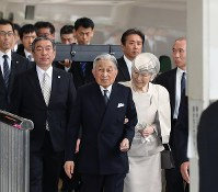 Emperor Akihito and Empress Michiko are seen on a platform at JR Tokyo Station before boarding a Tokaido Shinkansen bullet train to visit Ise Jingu Shrine in Mie Prefecture on April 17, 2019. (Pool photo)