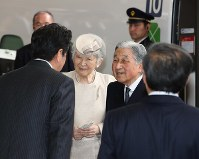 Emperor Akihito and Empress Michiko are seen off by Prime Minister Shinzo Abe at a platform at JR Tokyo Station before boarding a Tokaido Shinkansen bullet train to visit Ise Jingu Shrine in Mie Prefecture on April 17, 2019. (Pool photo)