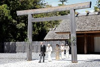Empress Michiko, second from left, visits the outer shrine of Ise Jingu Shrine in the city of Ise, Mie Prefecture, on April 18, 2019. (Pool photo)
