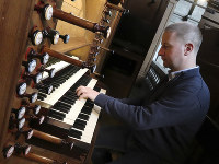 Johann Vexo, the organist who was playing at evening mass inside Notre Dame when flames began licking at the iconic cathedral's roof, plays the pipe organ at Notre Dame de Nancy cathedral, eastern France, on April 17, 2019. (AP Photo/Oleg Cetinic)