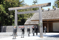Japanese Emperor Akihito, third from left, visits Ise Jingu, a Shinto shrine in Ise, Mie Prefecture, on April 18, 2019, for a ritual related to his upcoming abdication on April 30. Brought in separate boxes are the imperial sword, pictured at front, and jewel -- two of the family's three sacred treasures that play a key role in the succession. The last treasure, a mirror, is kept at the shrine. (Pool photo)