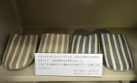Two pairs of slippers that were worn by Emperor Akihito and Empress Michiko are displayed in a cabinet at the chairman's room at Ise City Council of Social Welfare in Mie Prefecture. (Mainichi/Yuki Kozawa)