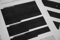 Special counsel Robert Mueller's report, with redactions, as released on April 18, 2019, is photographed in Washington. (AP Photo/Jon Elswick)