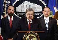 Attorney General William Barr speaks alongside Deputy Attorney General Rod Rosenstein, right, and acting Principal Associate Deputy Attorney General Edward O'Callaghan, left, about the release of a redacted version of special counsel Robert Mueller's report during a news conference, on April 18, 2019, at the Department of Justice in Washington. (AP Photo/Patrick Semansky)