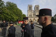 Members of the Paris Firefighters' brigade enter the security perimeter to Notre Dame cathedral on April 18, 2019 in Paris. (AP Photo/Michel Euler, Pool)