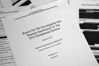 U.S. Special counsel Robert Mueller's redacted report on Russian interference in the 2016 presidential election as released on April 18, 2019, is photographed in Washington. (AP Photo/Jon Elswick)