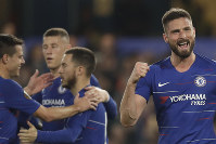 Chelsea's Olivier Giroud, the Europa League's top scorer, right, celebrates scoring his side's third goal during the Europa League quarterfinal, second leg, soccer match between Chelsea and Slavia Prague at Stamford Bridge stadium in London, on April 18, 2019. (AP Photo/Matt Dunham)
