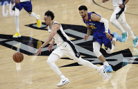 San Antonio Spurs guard Derrick White (4) drives past Denver Nuggets guard Jamal Murray (27) during the first half of Game 3 of an NBA basketball playoff series in San Antonio, April 18, 2019. (AP Photo/Eric Gay)