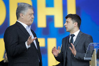 Ukrainian President Petro Poroshenko, left, and Ukrainian presidential candidate and popular comedian Volodymyr Zelenskiy, right, argue during their debates at the Olympic stadium in Kiev, Ukraine, on April 19, 2019. (AP Photo/Vadim Ghirda)